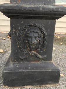 carved lion garden urn