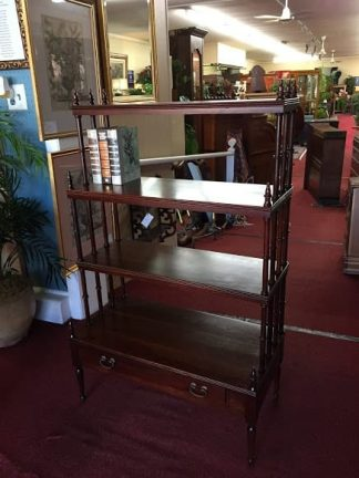 walnut bookcase with spindle sides