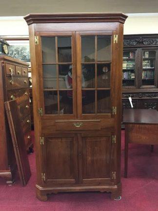 suter's walnut corner cabinet